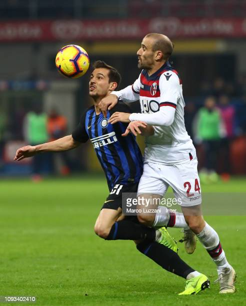 Cedric Soares of FC Internazionale competes for the ball with Rodrigo Palacio of Bologna FC during the Serie A match between FC Internazionale and...