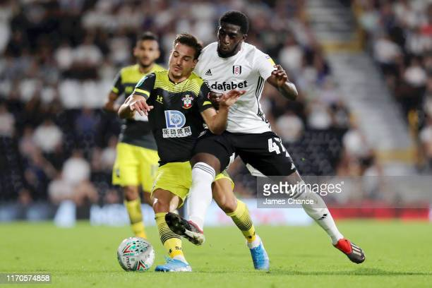 Cedric Soares of Southampton and Aboubakar Kamara of Fulham battle for possession during the Carabao Cup Second Round match between Fulham and...