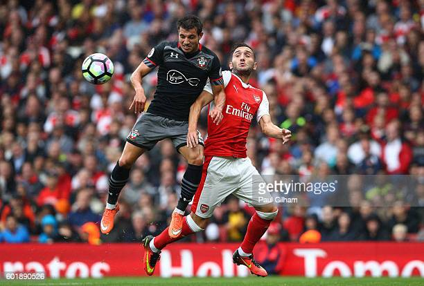 Cedric Soares of Southampton and Lucas Perez of Arsenal battle for possession during the Premier League match between Arsenal and Southampton at...