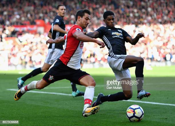 Cedric Soares of Southampton and Marcus Rashford of Manchester Unted battle for possession during the Premier League match between Southampton and...