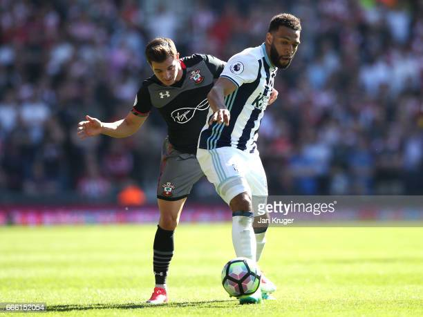Cedric Soares of Southampton and Matt Phillips of West Bromwich Albion battle for possession during the Premier League match between West Bromwich...