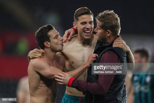 Cedric Soares of Southampton and PiereeEmile Hojbjerg of Southampton celebrate at full time during the Premier League match between Swansea City and...