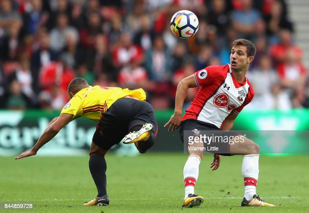 Cedric Soares of Southampton and Richarlison de Andrade of Watford clash during the Premier League match between Southampton and Watford at St Mary's...