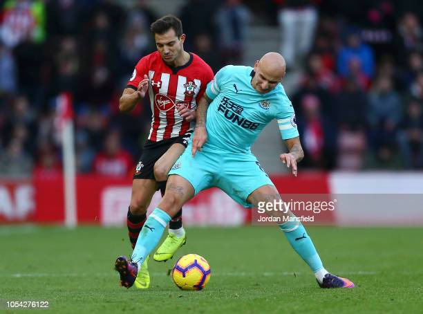 Cedric Soares of Southampton battles for possession with Jonjo Shelvey of Newcastle United during the Premier League match between Southampton FC and...