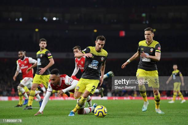 Cedric Soares of Southampton challenges PierreEmerick Aubameyang of Arsenal during the Premier League match between Arsenal FC and Southampton FC at...