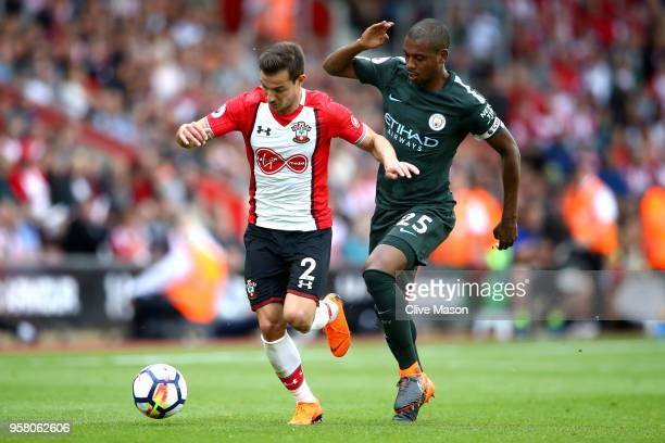 Cedric Soares of Southampton controls the ball as Fernandinho of Manchester City looks on during the Premier League match between Southampton and...