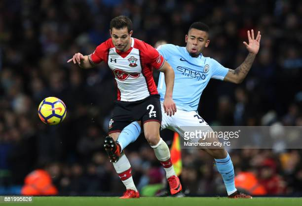Cedric Soares of Southampton is challenged by Gabriel Jesus of Manchester City during the Premier League match between Manchester City and...