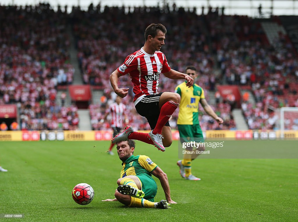 Cedric Soares of Southampton is challenged by Jonny Howson of Norwich City during the Barclays Premier League match between Southampton and Norwich City at St Mary's Stadium on August 30, 2015 in Southampton, England.