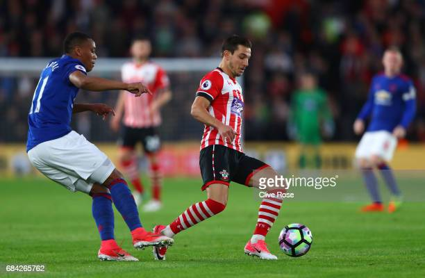 Cedric Soares of Southampton is put under pressure from Anthony Martial of Manchester United during the Premier League match between Southampton and...