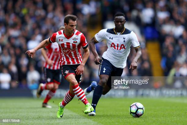 Cedric Soares of Southampton is put under pressure from Victor Wanyama of Tottenham Hotspur during the Premier League match between Tottenham Hotspur...
