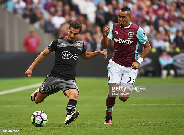 Cedric Soares of Southampton is watched by Dimitri Payet of West Ham United during the Premier League match between West Ham United and Southampton...