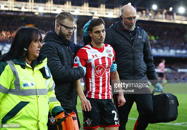 Cedric Soares of Southampton receives treatment from the medical team during the Premier League match between Everton and Southampton at Goodison...