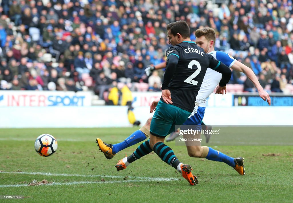 Cedric Soares of Southampton (2) scores their second goal during The Emirates FA Cup Quarter Final match between Wigan Athletic and Southampton at DW Stadium on March 18, 2018 in Wigan, England.