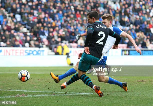 Cedric Soares of Southampton scores their second goal during The Emirates FA Cup Quarter Final match between Wigan Athletic and Southampton at DW...