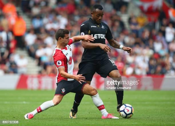 Cedric Soares of Southampton tackles Jordan Ayew of Swansea City during the Premier League match between Southampton and Swansea City at St Mary's...