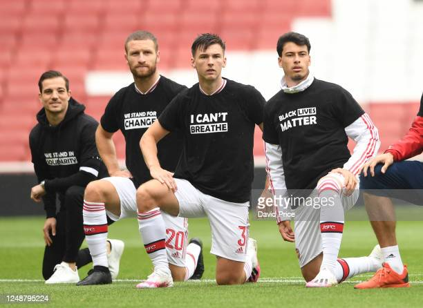Cedric Soares Shkodran Mustafi Kieran Tierney and Gabriel Martinelli of Arsenal take a knee in support of Black Lives Matter before the friendly...
