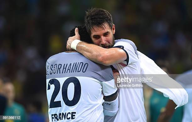 Cedric Sorhaindo and Nikola Karabatic of France celebrate their victory after the Men's Quarterfinal Handball contest against Brazil at Future Arena...