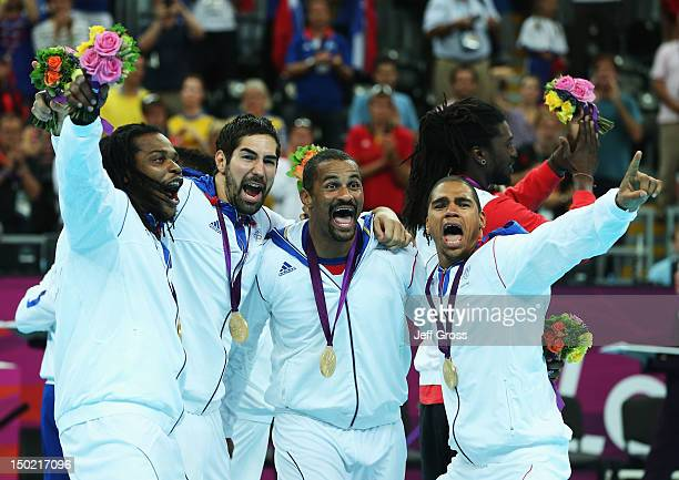 Cedric Sorhaindo, Nikola Karabatic, Didier Dinart and Daniel Narcisse of France celebrate after winning the gold medal against Sweden during the...