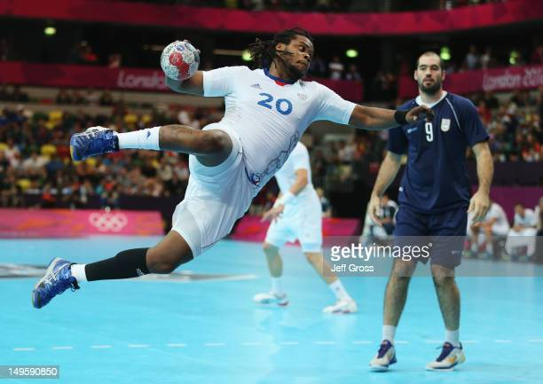Cedric Sorhaindo of France shoots for goal during the Men's Handball Preliminary match between Argentina and France on Day 4 of the London 2012...