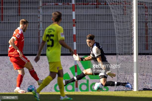 Cedric Teuchert of 1. FC Union Berlin and goalkeeper Fabian Giefer of FC Wuerzburger Kickers during the pre-season friendly match between 1. FC Union...