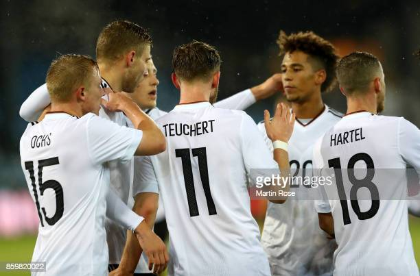 Cedric Teuchert of Germany celebrate with his teammates after he scores the opening goal during the UEFA Under21 Euro 2019 Qualifier match between...