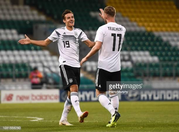 Cedric Teuchert of Germany celebrates after scoring his sides third goal with Florian Neuhaus during the 2019 UEFA European Under-21 Championship...