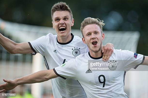 Cedric Teuchert of Germany celebrates his team's second goal with team mate Gino Fechner during the UEFA Under19 European Championship match between...