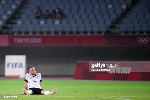 Cedric Teuchert of Team Germany looks dejected following the Men's Group D match between Germany and Cote d'Ivoire on day five of the Tokyo 2020...