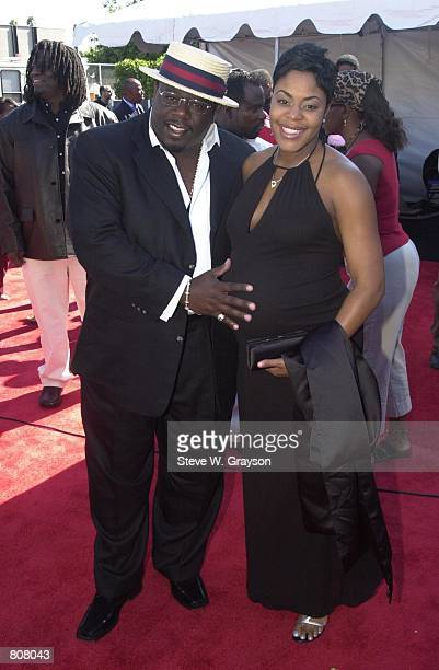 Cedric The Entertainer and wife pose for photographers at the 2000 Soul Train Lady Soul Awards September 2 2000 in Santa Monica California