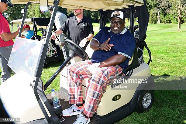 Cedric the Entertainer in his golf cart at the Julius Erving Golf Classic at Aronimink Golf Club on September 14 2015 in Newtown Pennsylvania