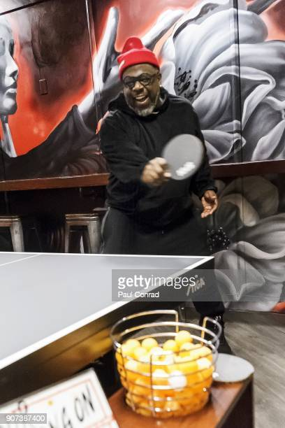 Cedric the Entertainer plays table tennis in Marty's Private Room during the SPiN VIP Grand Opening on Friday January 19 2018 in Seattle Washington