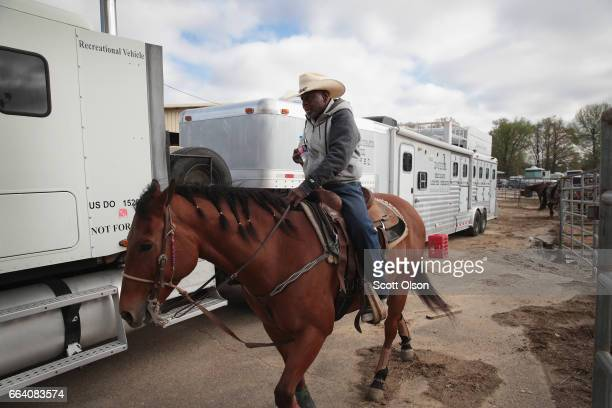 Cedrick Haynes rides his horse to the arena before the start of competition at the Bill Pickett Invitational Rodeo on March 31 2017 in Memphis...