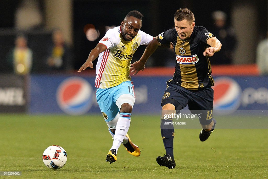 Cedrick Mabwati #11 of the Columbus Crew SC and Keegan Rosenberry #12 of the Philadelphia Union battle for position as they race to control the ball in the second half on March 12, 2016 at MAPFRE Stadium in Columbus, Ohio. Philadelphia defeated Columbus 2-1.