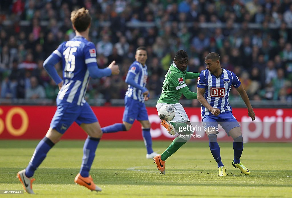 Cedrick Makiadi of Bremen and Marcel Ndjeng (R) of Berlin compete for the ball during the Bundesliga match between Werder Bremen and Hertha BSC at Weserstadion on May 3, 2014 in Bremen, Germany.