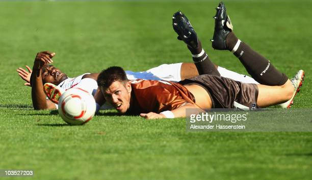 Cedrick Makiadi of Freiburg battles for the ball with Fabian Boll of FC St. Pauli during the Bundesliga match between SC Freiburg and St. Pauli at...