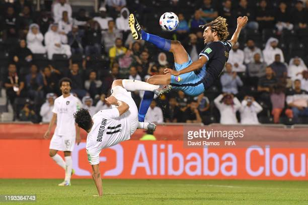 Cedrick Sansot of Hienghene Sport clashes with Baghdad Bounedjah of AlSadd Sports Club during the FIFA Club World Cup Qatar 2019 match between AlSadd...