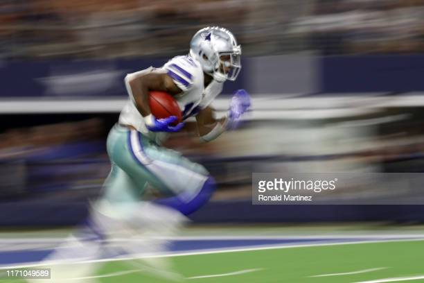 Cedrick Wilson of the Dallas Cowboys returns the ball against the Tampa Bay Buccaneers during a NFL preseason game at AT&T Stadium on August 29, 2019...