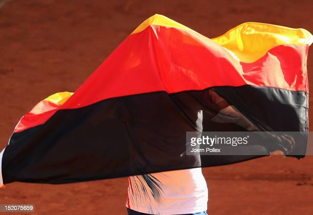 CedrikMarcel Stebe of Germany celebrates after winning his match against Lleyton Hewitt of Australia during the Davis Cup World Group PlayOff match...