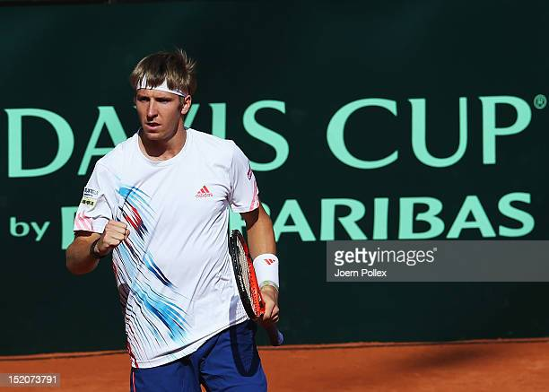 CedrikMarcel Stebe of Germany celebrates during his match against lleyton Hewitt of Australia during the Davis Cup World Group PlayOff match between...