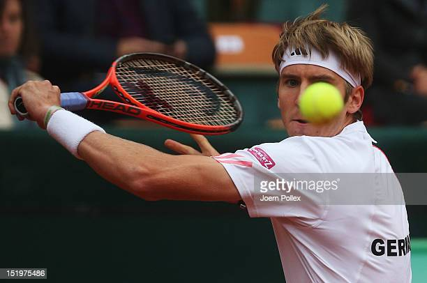 CedrikMarcel Stebe of Germany returns the ball to Bernard Tomic of Australia during the Davis Cup World Group PlayOff match between Germany and...