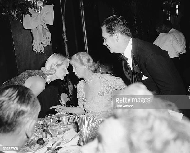 Cee Zee Guest and right Mme Louis Jacques Balsan talking at a party in Palm Beach mid 1950s Original Publication A Wonderful Time Slim Aarons