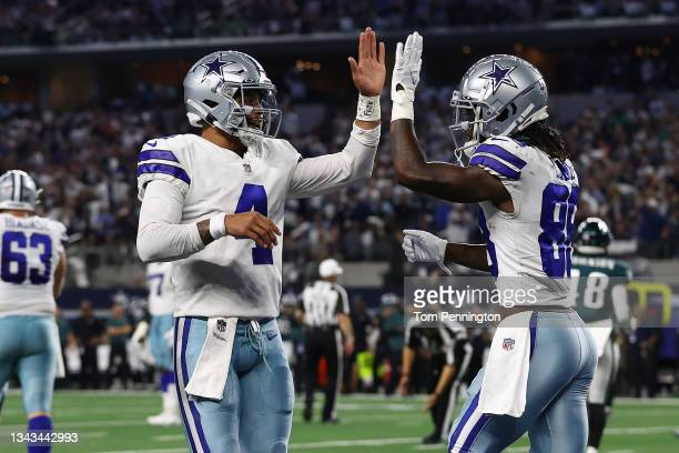 CeeDee Lamb of the Dallas Cowboys celebrates his second half touchdown with Dak Prescott while playing the Philadelphia Eagles at AT&T Stadium on...