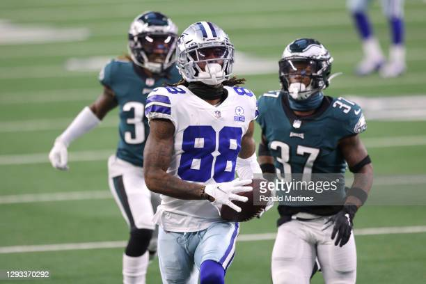 CeeDee Lamb of the Dallas Cowboys scores a touchdown in the third quarter against the Philadelphia Eagles at AT&T Stadium on December 27, 2020 in...