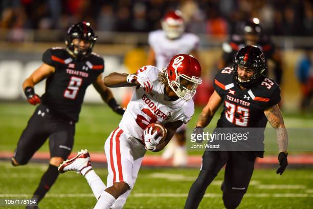 CeeDee Lamb of the Oklahoma Sooners gains yardage after making the catch during the second half of the game against the Texas Tech Red Raiders on...
