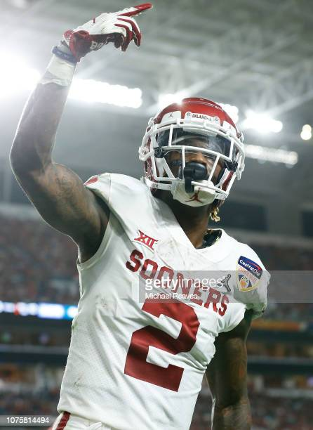 CeeDee Lamb of the Oklahoma Sooners reacts after completing the catch for a touchdown in the fourth quarter during the College Football Playoff...