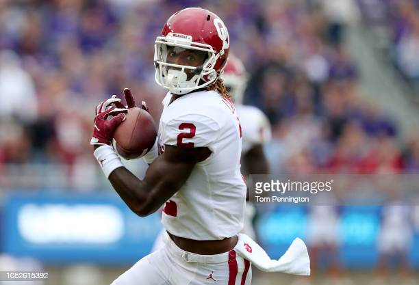 CeeDee Lamb of the Oklahoma Sooners scores a touchdown against the TCU Horned Frogs in the first half at Amon G Carter Stadium on October 20 2018 in...
