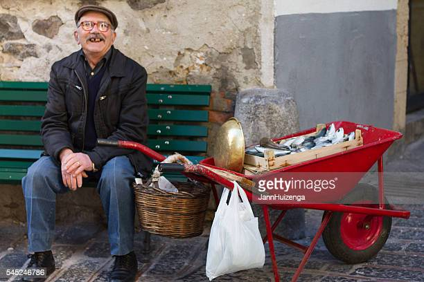 Cefalu, Sicily: Fishmonger with Red Wheelbarrow Full of Fish