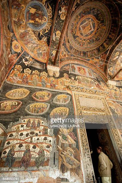 Ceiling and doorway in orthodox church with romanesque frescoes, Bucharest, Romania