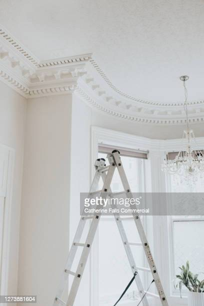 ceiling and step ladder in a bright, airy white room in a period style home - residential building stock pictures, royalty-free photos & images