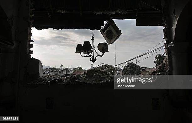 Ceiling lights and an air conditioner hang in the broken edifice of the Ministry of Finance on February 14 2010 in PortauPrince Haiti The 70...